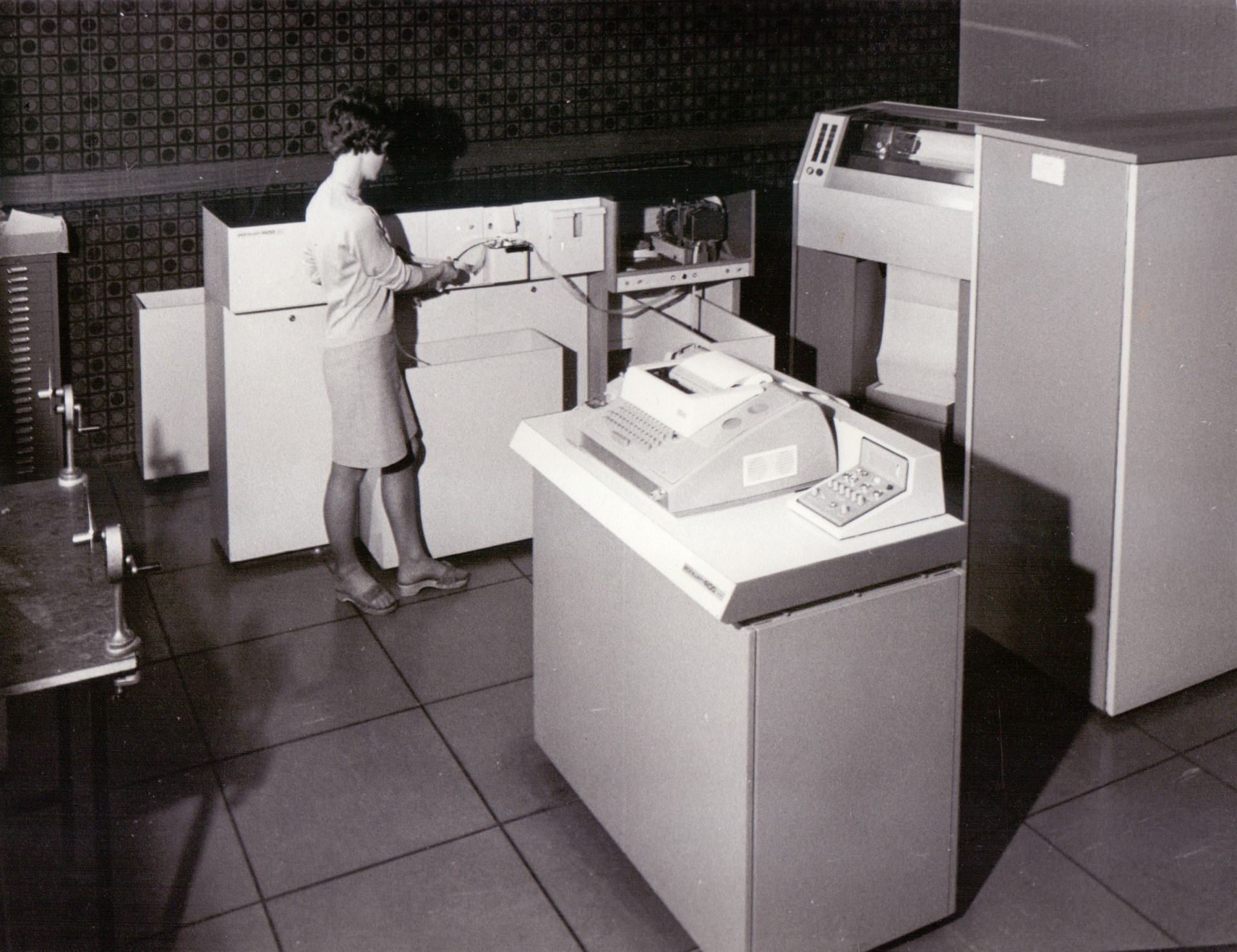 A member of staff operating an early computer